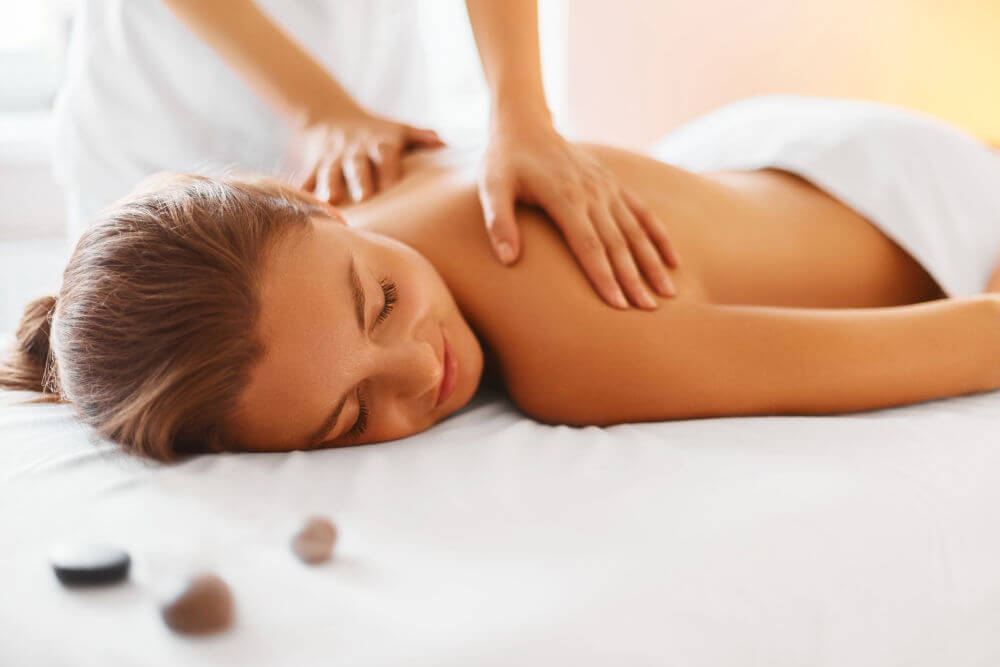 Chiropractor giving relaxing back massage